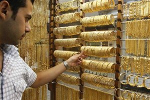A Jordanian salesman adjusts gold bangles inside a jewellery shop in Amman